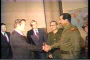 secretary shakes hand with Saddam Rumsfeld circa 1983